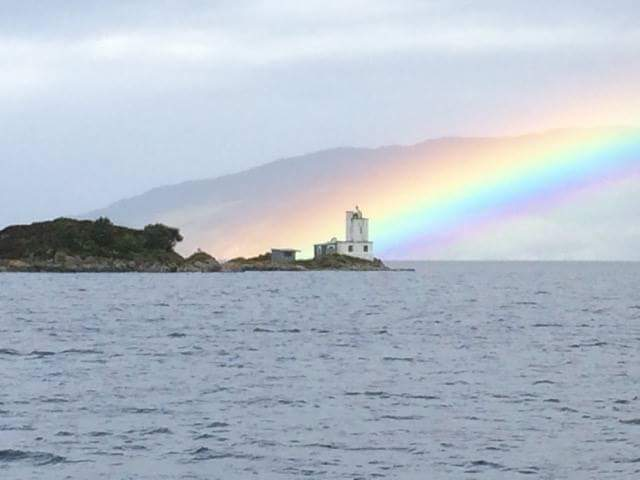 rainbow sailing on lighthouse